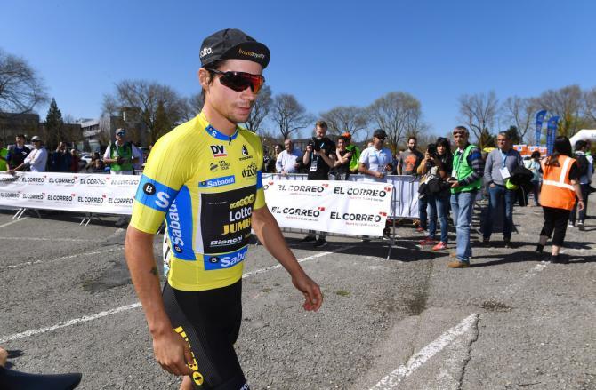 Race leader Primoz Roglic walks to sign on