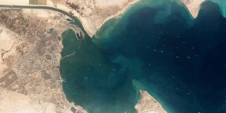 This photo, captured by one of Planet's Dove Earth-imaging cubesats on March 25, 2021, shows the container ship Ever Given stuck in the Suez Canal (top left) and the queue of ships waiting to enter the canal from the Red Sea.
