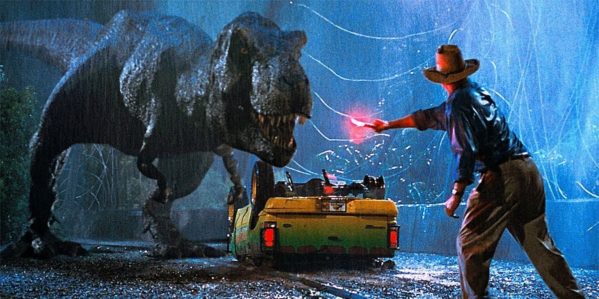 Dr. Grant waves a flare in front of the T-Rex in 'Jurassic Park'