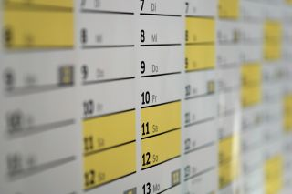 Calendar apps: Closeup on physical wall calendar