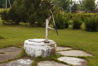 Water well and pump.