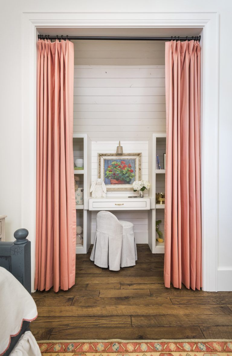 kids desk area in alcove with curtains