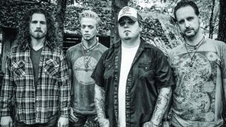 Black Stone Cherry standing in a line, looking at the camera.