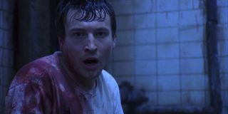 Leigh Whannell shocked and bloody in Saw 2004