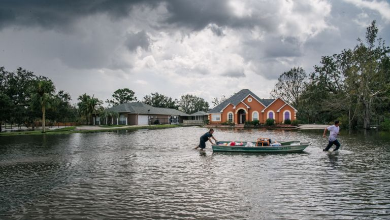 Hurricane Ida: Residents move a boat through a flooded neighborhood on August 31, 2021 in Barataria, Louisiana. Many stores remain closed and services suspended as power throughout New Orleans and its surrounding region is down