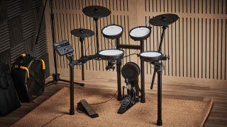 Roland TD-07KV electronic drum kit against a wooden wall
