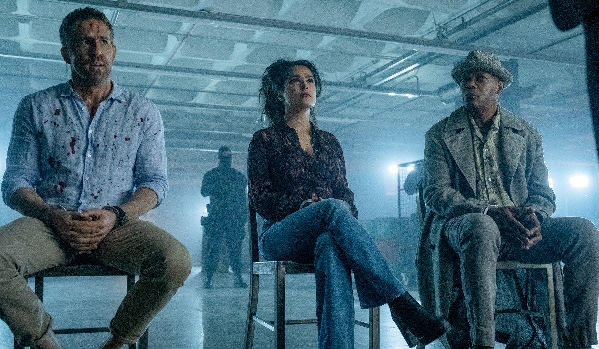 Ryan Reynolds, Salma Hayek, and Samuel L. Jackson sit as a captive audience in The Hitman's Wife's Bodyguard.
