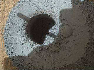 NASA's Mars rover Curiosity drilled this sample-collecting hole into a rock called Telegraph Peak on Feb. 24, 2015.
