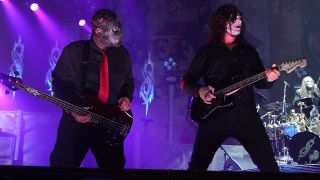 Paul Gray and Jim Root onstage with Slipknot in 2009