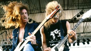 Cliff Burton and James Hetfield live in 1984