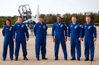 Space shuttle Discovery's STS-133 crew arrives at NASA's Kennedy Space Center on Feb. 20, 2011. From left: Nicole Stott, Michael Barratt, Steve Bowen, Al Drew, Eric Boe and Steven Lindsey.