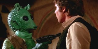 Greedo holding a gun to Han Solo in A New Hope