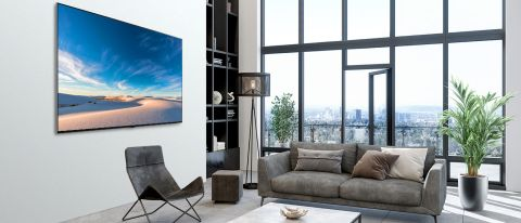 LG QNED MiniLED 99 Series 8K TV hanging on wall in living room