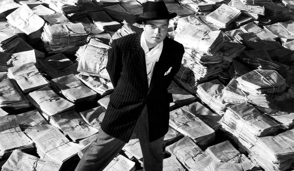 Citizen Kane Orson Wells Kane stands on the news