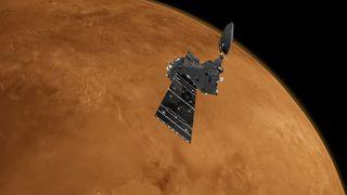 An artist's depiction of ESA's Trace Gas Orbiter at work around Mars.
