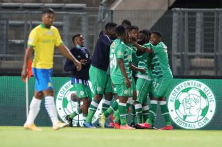 Victor Letsoalo celebrates his goal with teammates