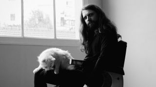 Artist Valnoir with his cat