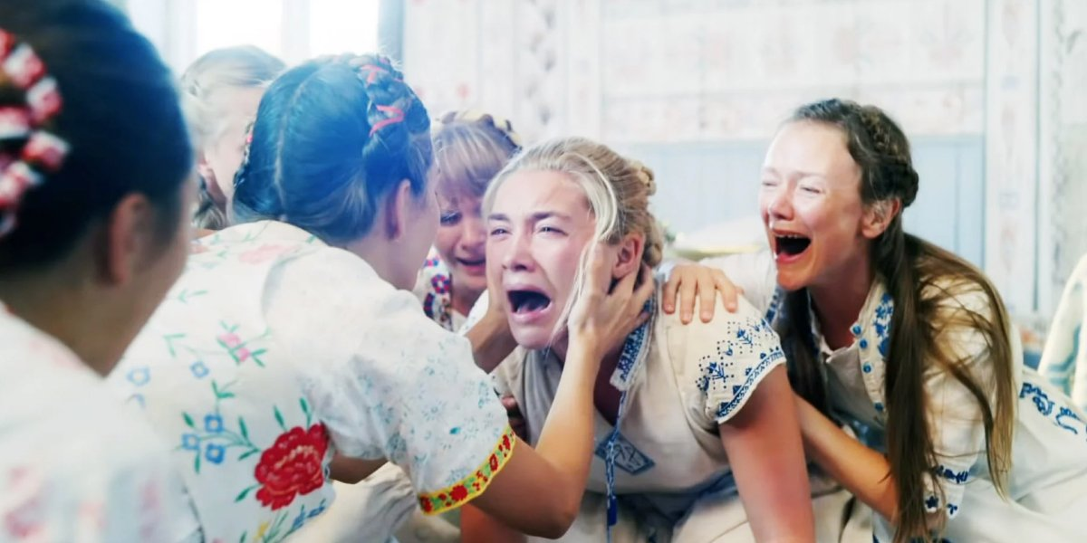 Florence Pugh surrounded by natives in Midsommar