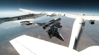 Virgin Galactic's SpaceShipTwo VSS Unity separates from its carrier planet, the VMS Eve, during its second glide flight over Spaceport America in New Mexico on June 25, 2020.