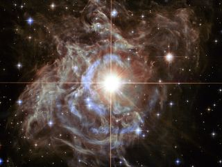 A Hubble Space Telescope image shows RS Puppis, one of the cepheids used to measure the expansion of the universe.