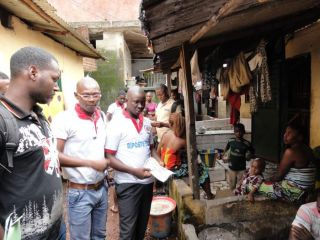 Photo from the 2014 Ebola outbreak in Guinea. Volunteers go door-to-door sharing information about the deadly virus.