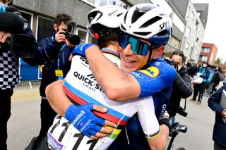 Davide Ballerini hugs Deceuninck-QuickStep teammate Julian Alaphilippe after winning Omloop Het Nieuwsblad