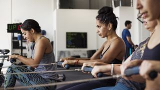 How to use a rowing machine to lose weight - A group of women using rowing machines