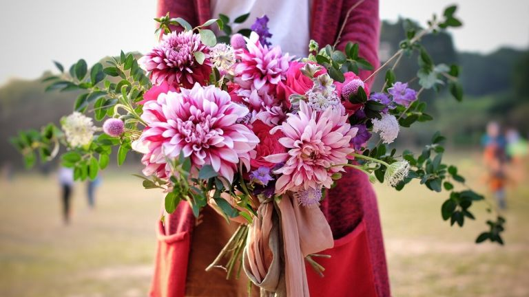 Woman holding bouquet of pink flowers