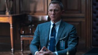 Daniel Craig sits patiently in M's office in No Time To Die.