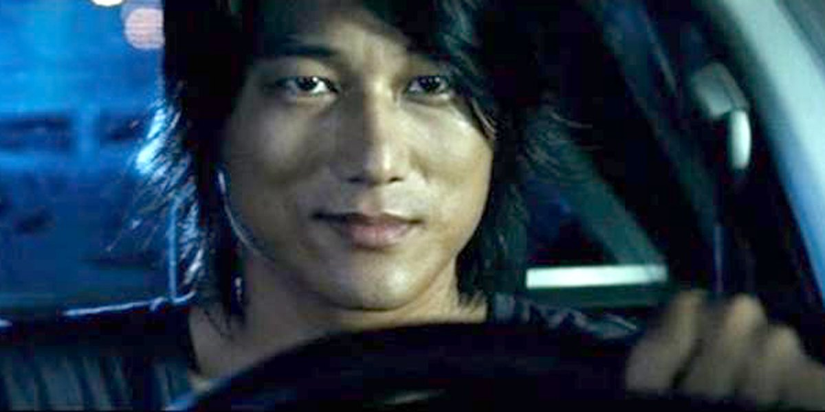 Fast and Furious Han Lue actor Sung Kang behind the wheel of a car