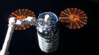 An Orbital ATK Cygnus cargo spacecraft arrives at the International Space Station in October. After departing the ISS, the Cygnus raised its orbit and deployed four Spire cubesats Nov. 25, 2016.