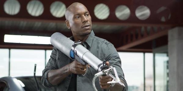Tyrese Gibson as Roman Pearce with a harpoon gun