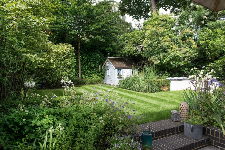 kids garden with lawn and playhouse