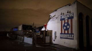 "A mural reading ""I believe in Nashville"" remains intact on a collapsed wall in the East Nashville neighborhood on March 3, 2020 in Nashville, Tennessee."