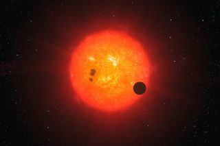 Artist's impression of an exoplanet transiting a red dwarf star.