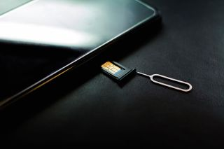 SIM card going into smartphone.