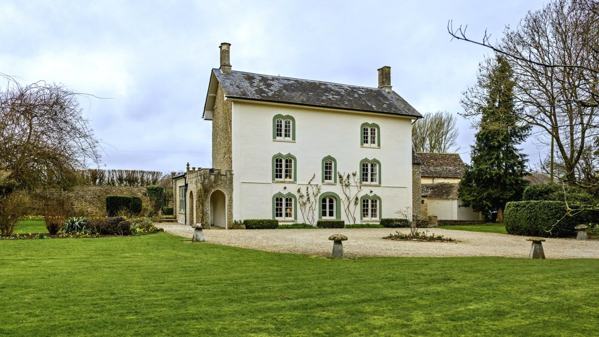 This country house hides a traditional Cotswold cottage behind a Gothic facade