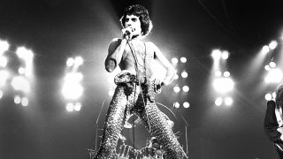 Freddie Mercury of Queen performs on stage at Earls Court on June 6th 1977 in London