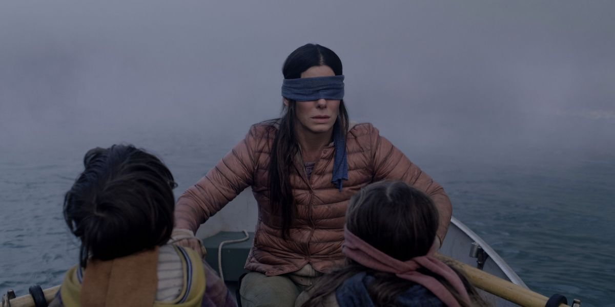 Sandra Bullock blindfolded on a boat with Boy and Girl in Birdbox
