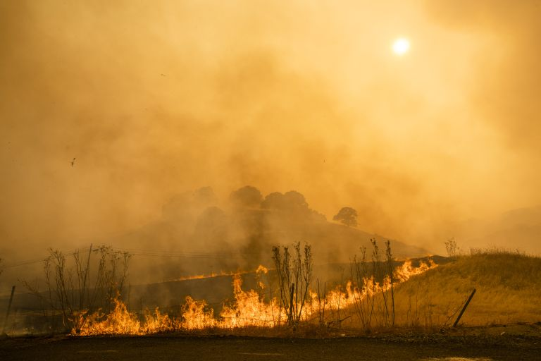 Flames and smoke from wildfires cover the landscape in California, U.S.