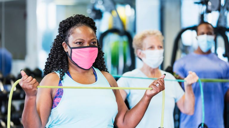 Woman doing chest workouts with resistance bands