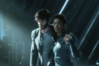 "Burnham (Sonequa Martin-Green) helps her adoptive sibling Spock (Ethan Peck) get to the planet Talos IV to get the help he needs in the ""Star Trek: Discovery"" episode ""If Memory Serves."""