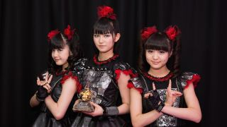 Babymetal holding a Metal Hammer Golden God Award