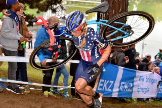 US cyclo-cross champion Katie Compton shoulders her bike during round 2 of the 2019/20 UCI Cyclo-cross World Cup in Bern, Switzerland