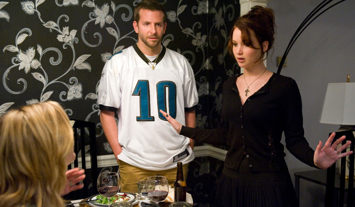 Silver Linings Playbook Jennifer Lawrence makes a scene at dinner while Bradley Cooper watches