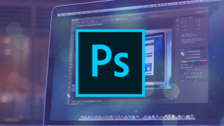 Photoshop logo in front of a laptop