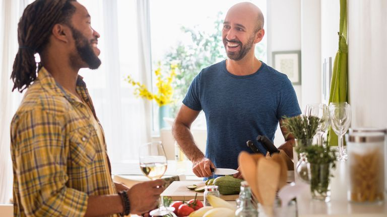Couple preparing healthy foods to cut calories