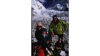 English mountain-climber Alison Hargreaves on a mountain surrounded by her husband Jim and children Tom and Katie
