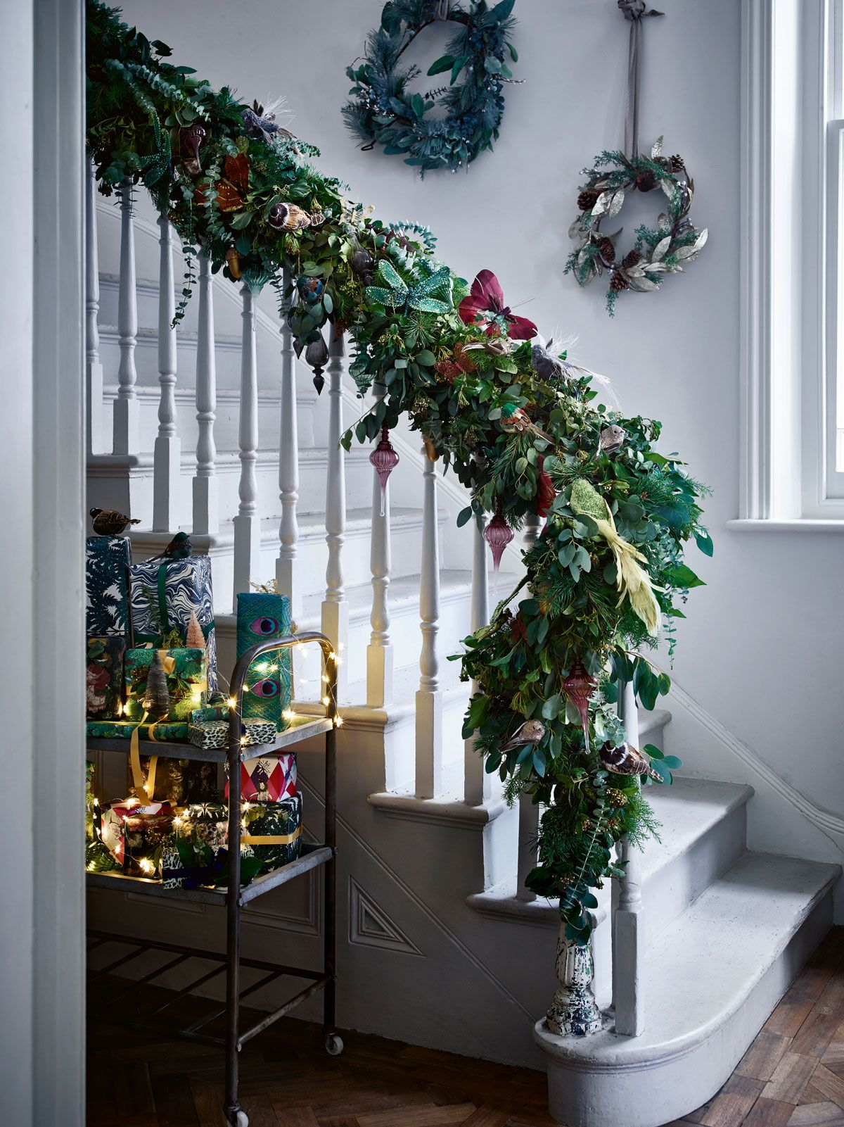 Kick off the Christmas illusion with a forest green garland