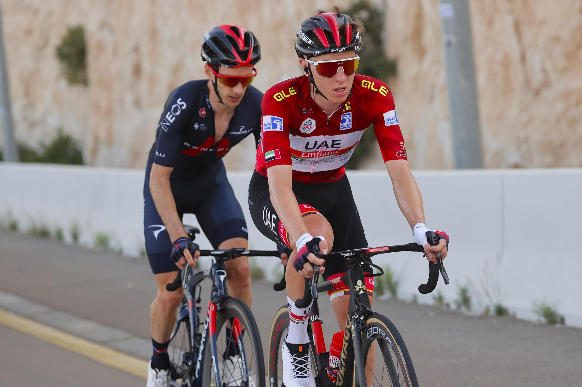 Tadej Pogacar leads Adam Yates on the climb